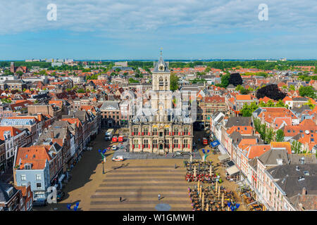 High angle view on Market Square and City Hall in Delft, Netherlands. Delft is an old Dutch city, known for its pottery ('Delfts Blauw') and canals.
