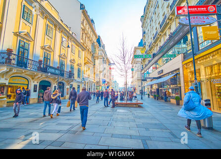VIENNA, AUSTRIA - FEBRUARY 18, 2019: The wide shopping Karntner street with numerous boutiques, restaurants and casino leading to the Opera House, on - Stock Photo