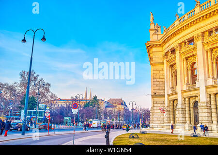 VIENNA, AUSTRIA - FEBRUARY 18, 2019: The Burgtheater of Vienna with rich decorations faces the busy Universitatsring and Rathauspark, on February 18 i - Stock Photo