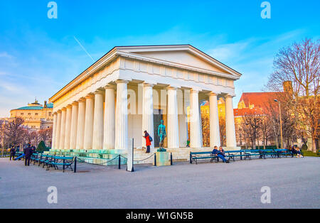 VIENNA, AUSTRIA - FEBRUARY 18, 2019: The replica of Greek Temple of Hephaestus, located in Volksgarten (People's Park) with bronze sculpture of Theseu - Stock Photo
