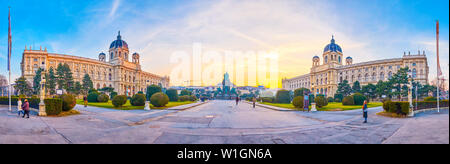 VIENNA, AUSTRIA - FEBRUARY 18, 2019: Panoramic view on Maria Theresien Platz with twin buildings of museums and sculpture of Maria Theresa in the midd - Stock Photo