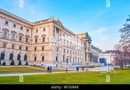 VIENNA, AUSTRIA - FEBRUARY 18, 2019: The magnificent back wall Hofburg Palace, adjoining with Burggarten, on February 18 in Vienna, Austria - Stock Photo