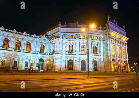 VIENNA, AUSTRIA - FEBRUARY 18, 2019: The bright illumination of  splendid facade of Burgtheater of Vienna, that faces on Universitatsring Strasse, on - Stock Photo