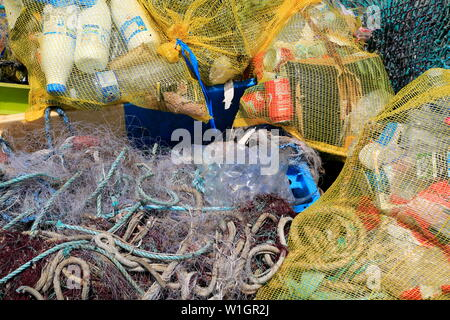 Plastic discarded in the sea, a danger to marine life. Planet Earth is mankind's dustbin - Stock Photo
