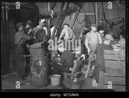 Millville, New Jersey - Glass bottles. T.C. Wheaton Co. Men working in shop. - Stock Photo