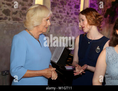 The Duchess Of Cornwall speaks to Alis Huws the new Official Harpist to the Prince of Wales, during an evening of music and drama at their Welsh home Llwynywermod in Llandovery, Carmarthenshire. - Stock Photo