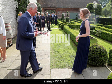 The Prince of Wales, Patron, The Royal Welsh College of Music and Drama, presents Alis Huws (right), his new Official Harpist, with the Royal Harpist's brooch, during an evening of music and drama at his Welsh home Llwynywermod in Llandovery, Carmarthenshire. - Stock Photo
