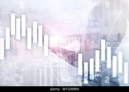 Financial Investment Concept. Stock market trading graph and candlestick chart - Stock Photo