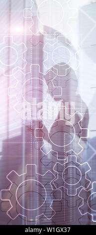 Vertical Panorama Banner. Double exposure gears mechanism on blurred background. Business and industrial process automation concept - Stock Photo