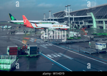 Seoul, South Korea - 03.13.2019: two planes at the airport are preparing to fly. maintenance of large aircraft at the airport. - Stock Photo