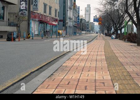 Seoul, South Korea - 18.03.18: deserted street in korea. a beautiful sidewalk for pedestrians on a Korean street. - Stock Photo