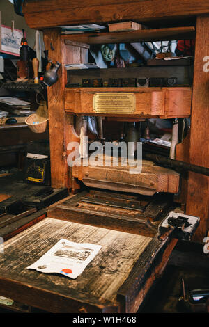 Bled, Slovenia - September, 8 2018: Close up of ancient wooden reconstructed Gutenberg's printing machine used now for making printed by tourists souv - Stock Photo