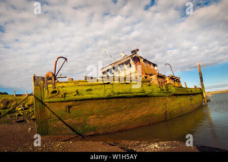 The remains of the 19th century steamer Mary D. Hume rest silently in the Rogue River in Gold Beach, OR. (c) 2012 Tom Kelly - Stock Photo