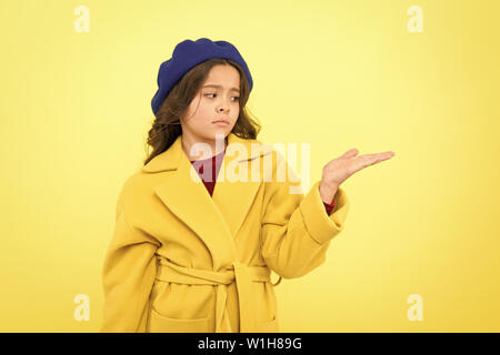 Place for ad advertisement. Child promoting something yellow background copy space. Girl show open palm. Advertising product. Look at this. Advertisement launching product. Advertisement concept. - Stock Photo