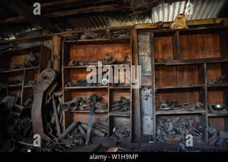 June 19, 2019 - Srinagar, Jammu and Kashmir, India - A view of the scrap materials inside a scrap shop in Srinagar.Recycling scrap metals has always been a potential business in which one can make money and even more so now with a huge emphasis on recycling. Millions of tons of scrap metal are processed every year, examples being cars, bikes, pots, polythene, radiators, appliances, pipes, electrical wires, sinks, old electronic appliances and many more. In Kashmir, a scrap processor is dealing with metallic scraps to have a detailed knowledge on overall demand of the products in the valley. S - Stock Photo