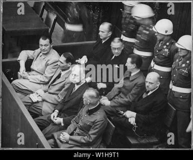 Nuremberg Trials. Defendants in their dock; Goering, Hess, von Ribbentrop, and Keitel in front row, circa 1945-1946., ca. 1945 - ca. 1946; General notes:  Use War and Conflict Number 1297 when ordering a reproduction or requesting information about this image. - Stock Photo