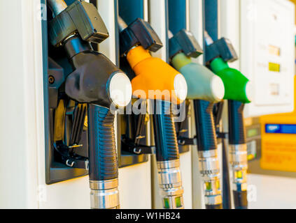 Gas station with four multi-colored handles close-up - Stock Photo