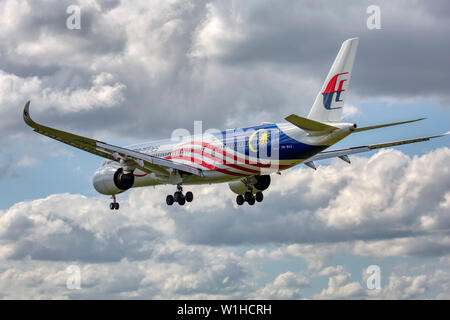 9M-MAG Malaysia Airlines Airbus A350-900 approaching to land at London Heathrow airport - Stock Photo