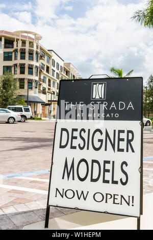 Naples Florida Mercato real estate mixed use development retail new construction condominium for sale sign designer models now o - Stock Photo
