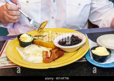 Florida Bonita Springs Mel's Diner restaurant casual dining nostalgia eat breakfast food French toast plate butter eggs bacon gr - Stock Photo