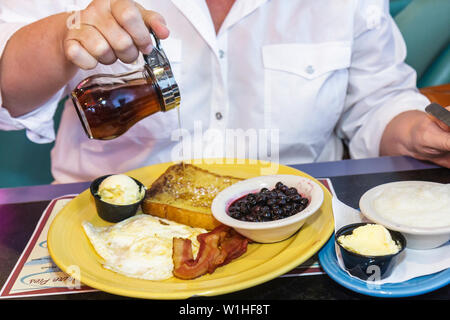 Florida Bonita Springs Mel's Diner restaurant casual dining nostalgia woman customer breakfast food French toast plate butter eg - Stock Photo