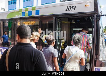 Miami Beach Florida Washington Avenue Metrobus bus public transportation mass transit Black Hispanic woman man passenger board - Stock Photo