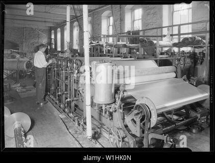 Paterson, New Jersey - Textiles. [Man working at machines.] - Stock Photo