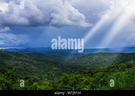Majestic mountains landscape under morning sky with clouds. Overcast sky before storm. - Stock Photo