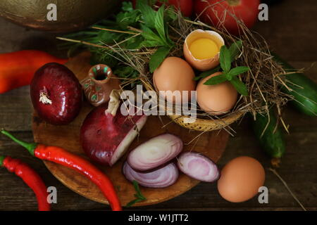 Fresh vegetables in the kitchen on a wooden table - Stock Photo
