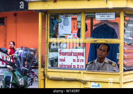 Bangkok, Thailand - April 12, 2019: Security officer standing in a yellow box in central Bangkok - Stock Photo