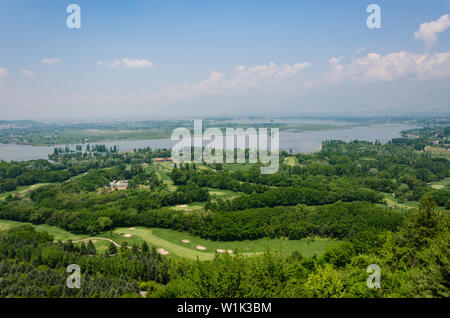 Beautiful view of the Dal Lake and surrounding lush green landscape as seen from Pari Mahal, Srinagar, Jammu and Kashmir, India - Stock Photo