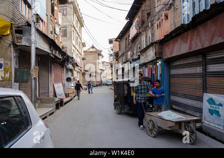 A street filled with abandoned Kashmiri Pandit houses at Habbakadal, Srinagar, Jammu and Kashmir, India - Stock Photo