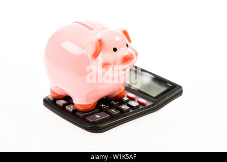 moneybox with calculator. Piggy bank. planning and counting budget. income capital management. bookkeeping. financial problem. money saving. Accounting and payroll. Wealthy and successful. - Stock Photo
