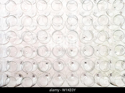 A lot of empty glasses for sparkling wine standing on the white table before the party, top view - Stock Photo