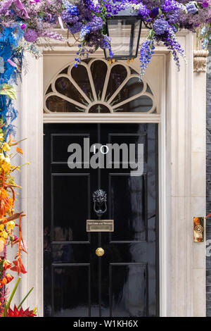 London, UK. 3rd July 2019.  Front door of 10 Downing Street, London  with LGBT flower display Credit Ian Davidson/Alamy Live News - Stock Photo