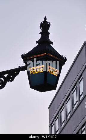 London, United Kingdom - April 01 2013:   A victorian Blue Lamp indicating the location of a  Metropolitan Police station on Grovesnor Hill - Stock Photo