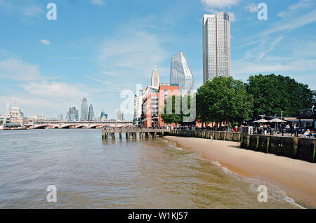 The South Bank of the River Thames, Central London, looking East towards the Oxo Tower, the South Bank Tower, One Blackfriars and the city - Stock Photo