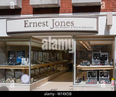 Swindon, United Kingdom - May 04 2019:   The frontage of Ernest Jones Jewelers in Regent Street - Stock Photo