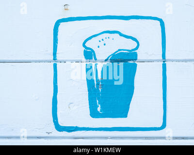 blue sign of a beer painted on white wood - Stock Photo