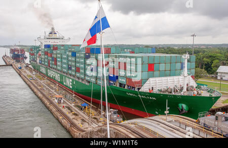Panama Canal / Panama - May 18.2007: View on the big container ship fully loaded sailing through the Panama Canal. Vessel slowly moving. - Stock Photo