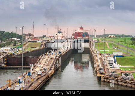Panama Canal / Panama - May 18.2007: View on the Panama Canal locks with water cascades and gateways. On the rails moving small powerful carts. - Stock Photo