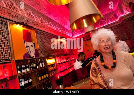 Woman at the bar in the Djellabar, Marrakech, Morocco - Stock Photo
