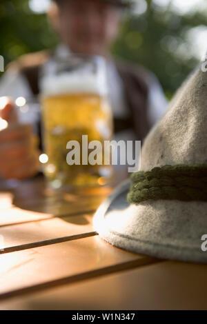 Bavarian man in beer garden, lake Starnberg, Bavaria, Germany - Stock Photo