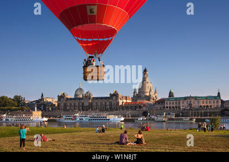 Balloons rising from the Elbe riverbank, Bruehlsche Terrasse and Frauenkirche in the background, Dresden, Saxonia, Germany, Europe - Stock Photo