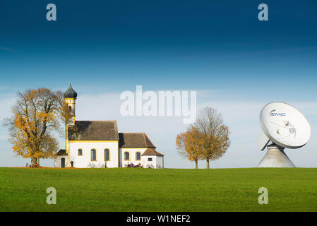 St. Johann Chapel and parabolic Antenna Satellite Dish in Raisting at the earth station, Raisting, Bavaria, Germany - Stock Photo