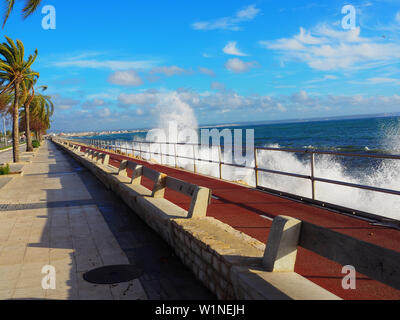 breaking waves on the coast in Palma de Mallorca on a windy day - Stock Photo