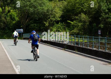 Pontsticill Reservoir, Brecon Beacons, South Wales, UK.  3 July 2019.  UK Weather: People cycle in the sunny weather this afternoon, as temperatures start to climb again.  Credit: Andrew Bartlett/Alamy Live News