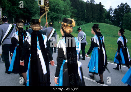 women wearing dirndl dresses, pilgrimage to Maria Eck, Siegsdorf, Chiemgau, Upper Bavaria, Bavaria, Germany - Stock Photo