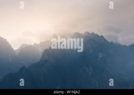 Jade Dragon Snow Mountain from Tiger Leaping Gorge, the finest hike in Yunnan province, China - Stock Photo