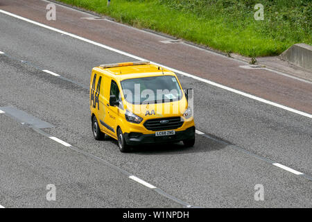 2019 Ford Transit Custom 340 Base; AA Van recovery truck. Side view of rescue breakdown recovery lorry truck transporter driving along  M6 motorway,  Lancaster, UK; Vehicular traffic, transport, modern, north-bound on the 3 lane highway. - Stock Photo